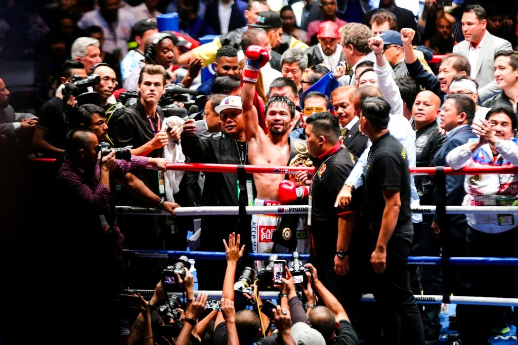 Pacquiao celebrates after beating Matthysse.