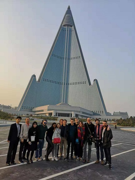 Group photo infront of Ryugyong Hotel